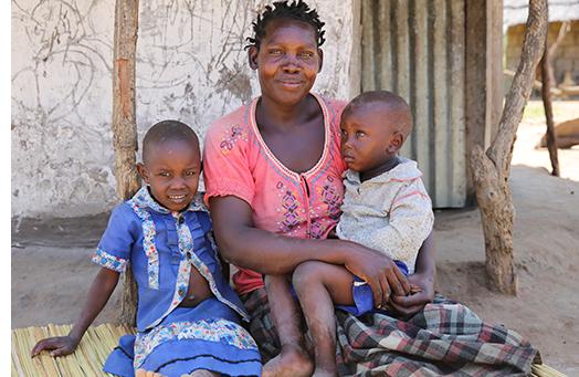 Village Enterprise entrepreneur, Lucy, with her two children