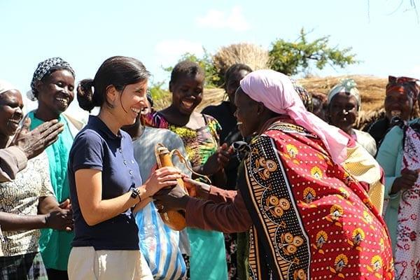 Village Enterprise staff and female entrepreneurs