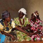 Village Enterprise women talking