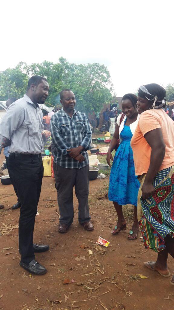 Village Enterprise staff talking