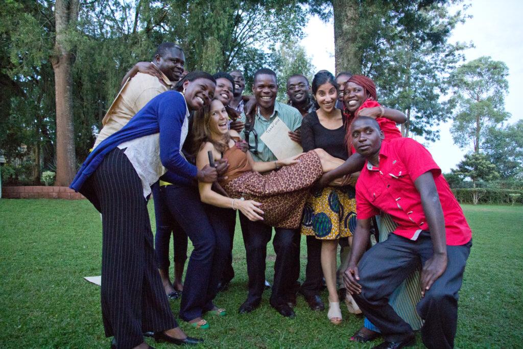 Members of the Village Enterprise field staff joking