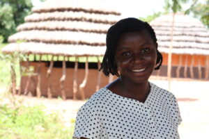 Village Enterprise business mentor Fiona Atimango in front of a village