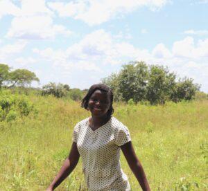 Village Enterprise business mentor Fiona Atimango in a field