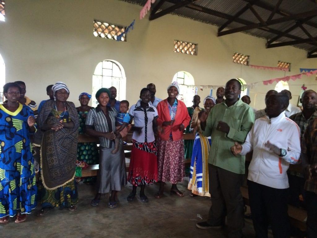 the people of Kakende, Uganda, singing and dancing
