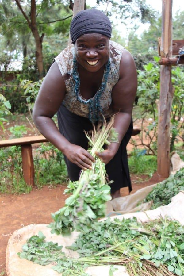 Village Enterprise business owner Betty Amase bundling plants