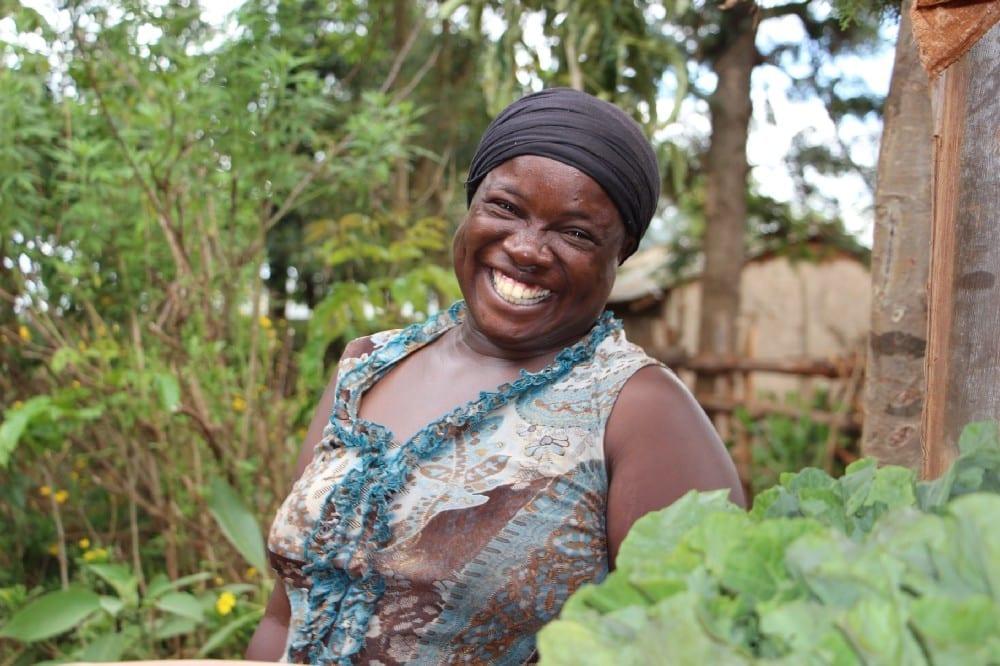 Village Enterprise business owner Betty Amase smiling