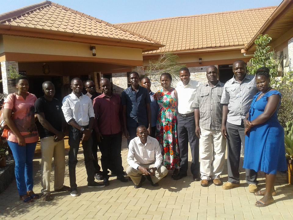 Village Enterprise field team poses for a picture before heading out for a day of learning in the field.