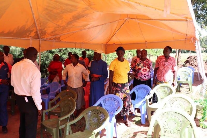 Village Enterprise business savings group members under theirtent