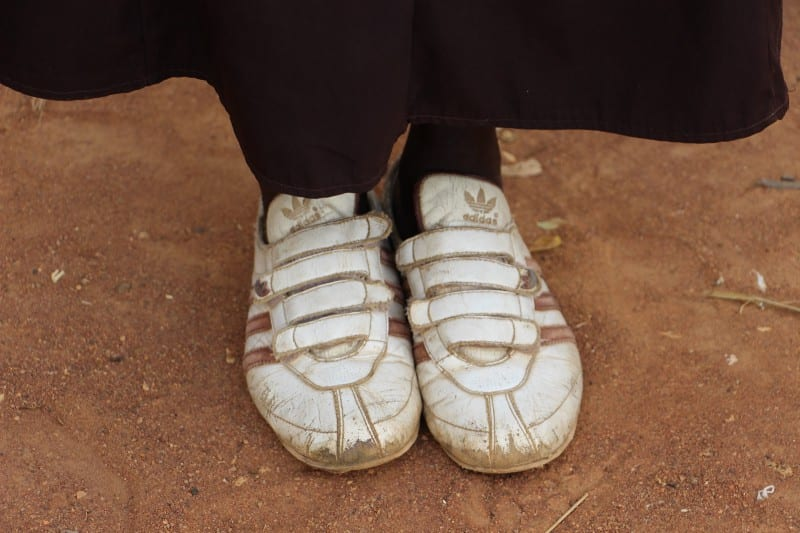shoes standing on dirt