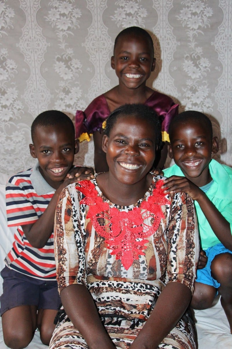 Village Enterprise business owner Lillian and her threechildren