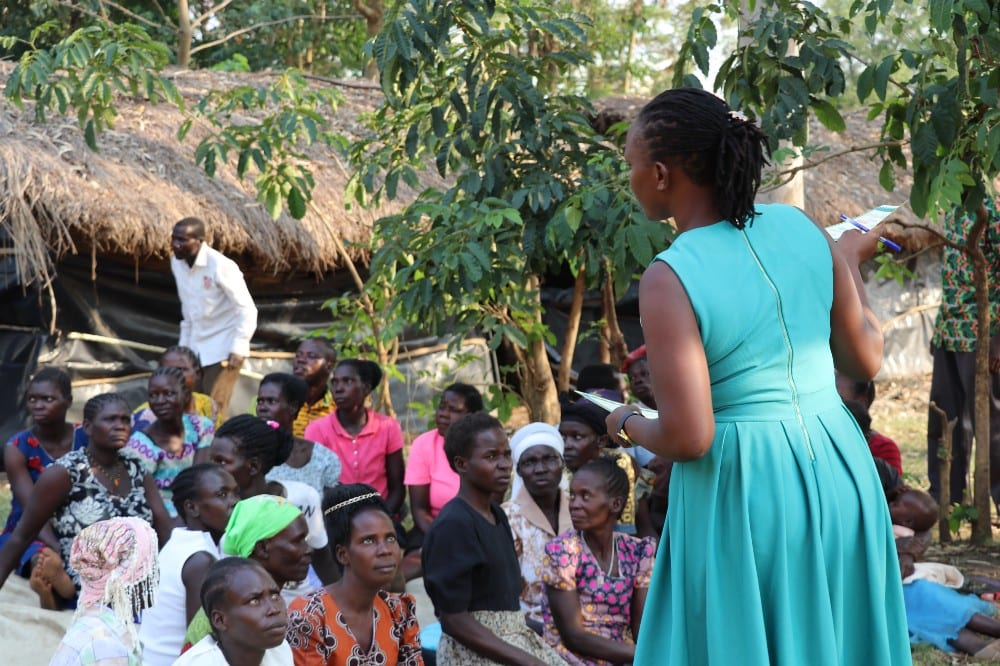 Zita Akwero mentoring Village Enterprise business owners in Nwoya, Uganda