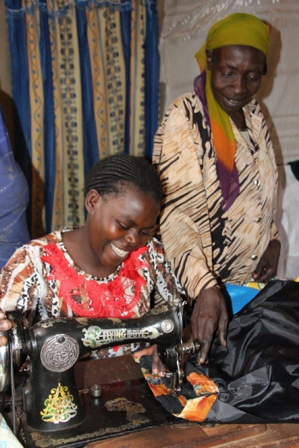 Village Enterprise business owners sew skirts to sell
