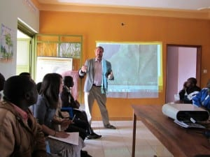 man presenting to Village Enterprise Hoima, Uganda, staff