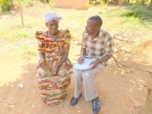 Village Enterprise staff talking to a Kenyan woman