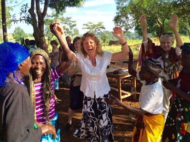 Christine Rose celebrating with Ugandan female business owners