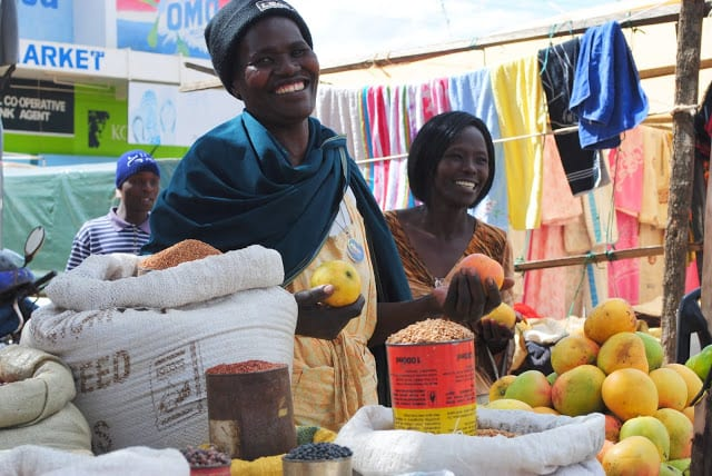 two African women selling fruit