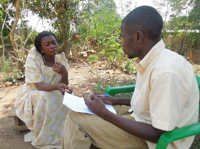 Village Enterprise Business Mentor, Gerald Kyalisiima participates in a mock field activity