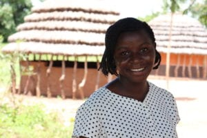 Village Enterprise business mentor Fiona Atimango in front of a village
