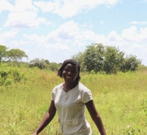 Village Enterprise business mentor Fiona Atimango in a field