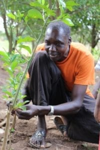 Emukajo Gilbert showing his plants