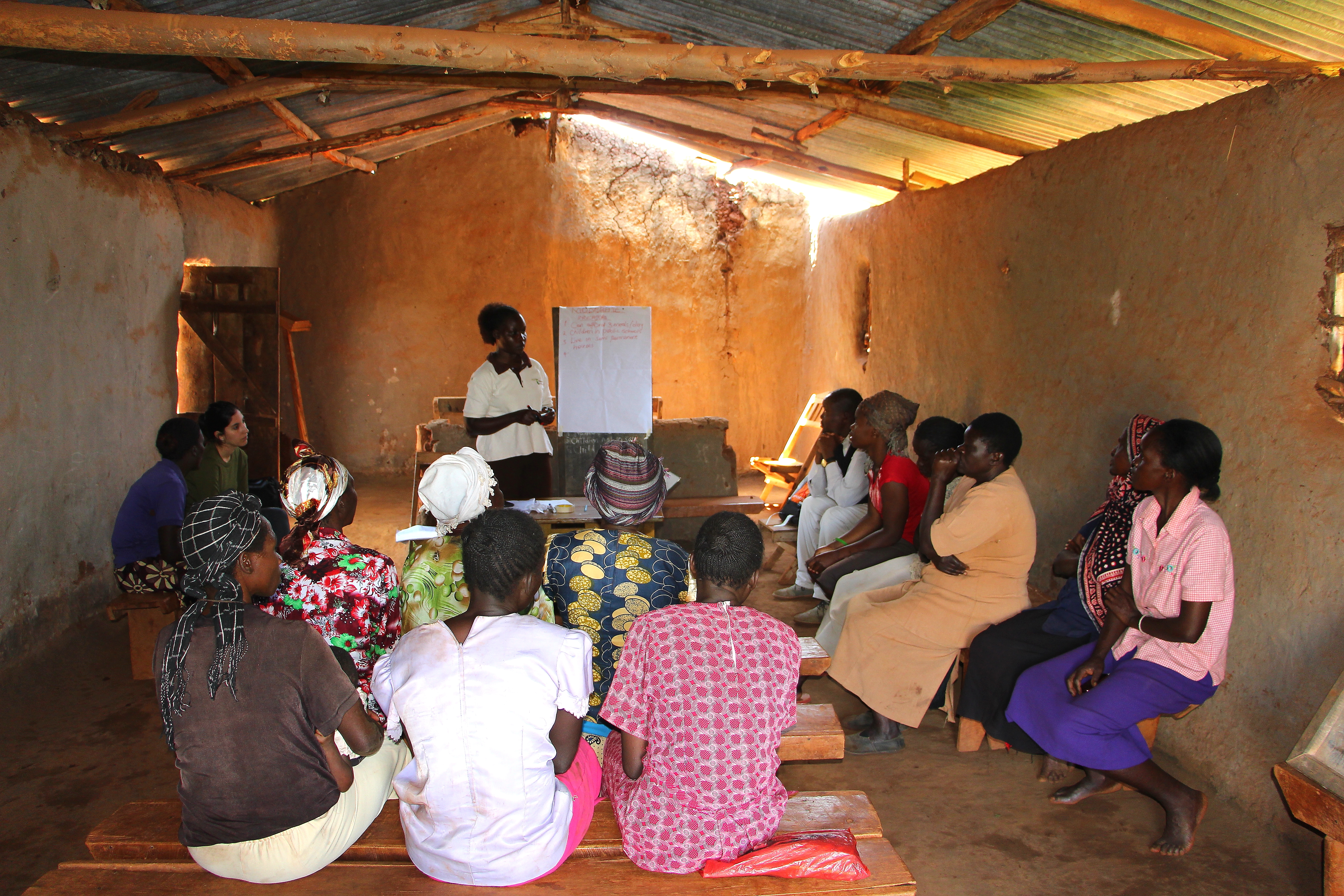 Opinion leaders in Sibanga Village, Kenya, gather to participate in the Village Enterprise PWR.