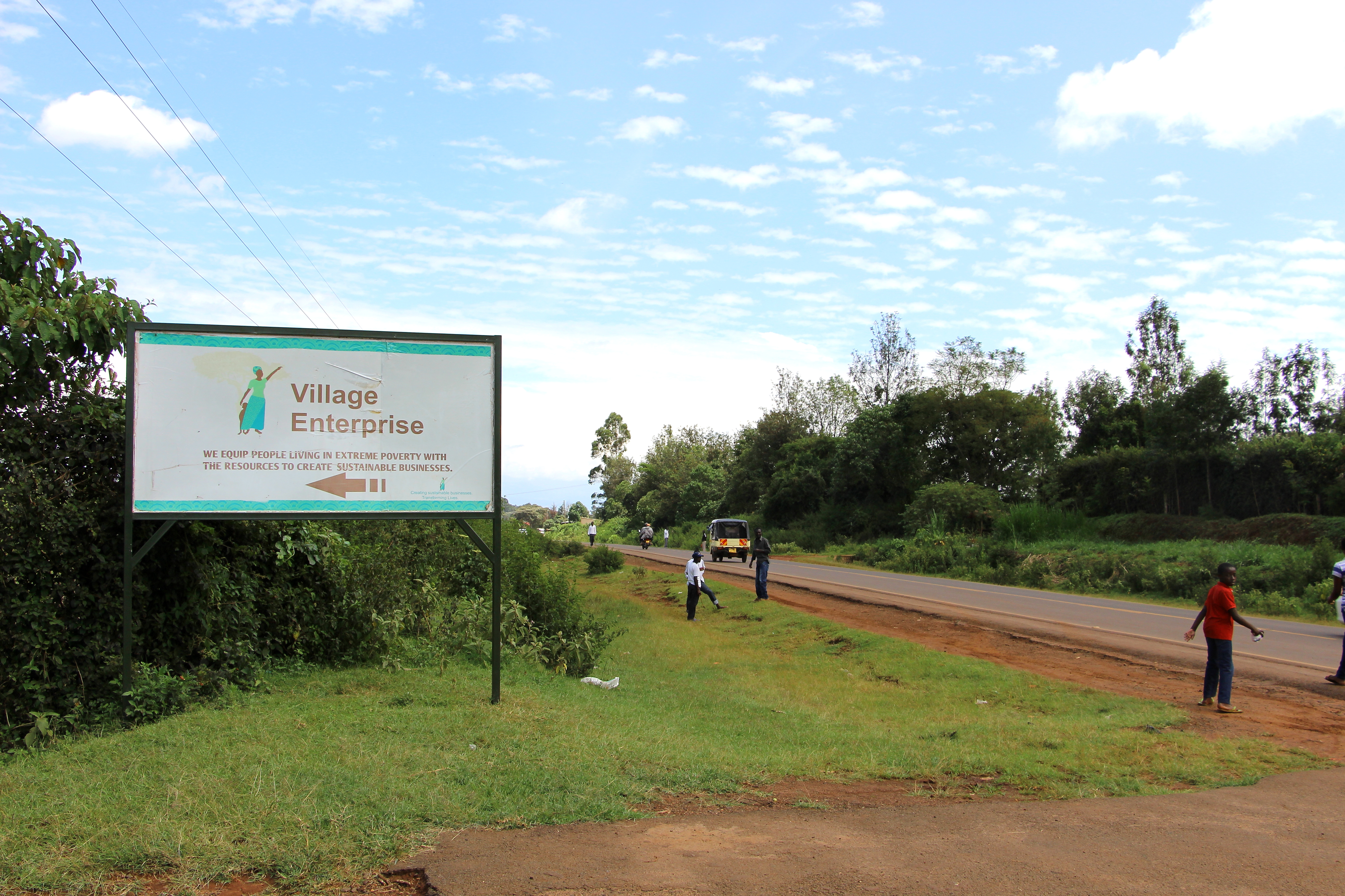 Roadside sign pointing to Village Enterprise Kitale, Kenya, office