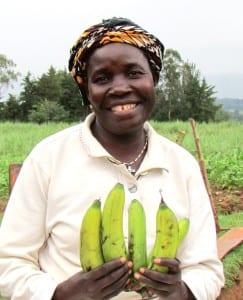 Emma, Village Enterprise business owner, holding bananas