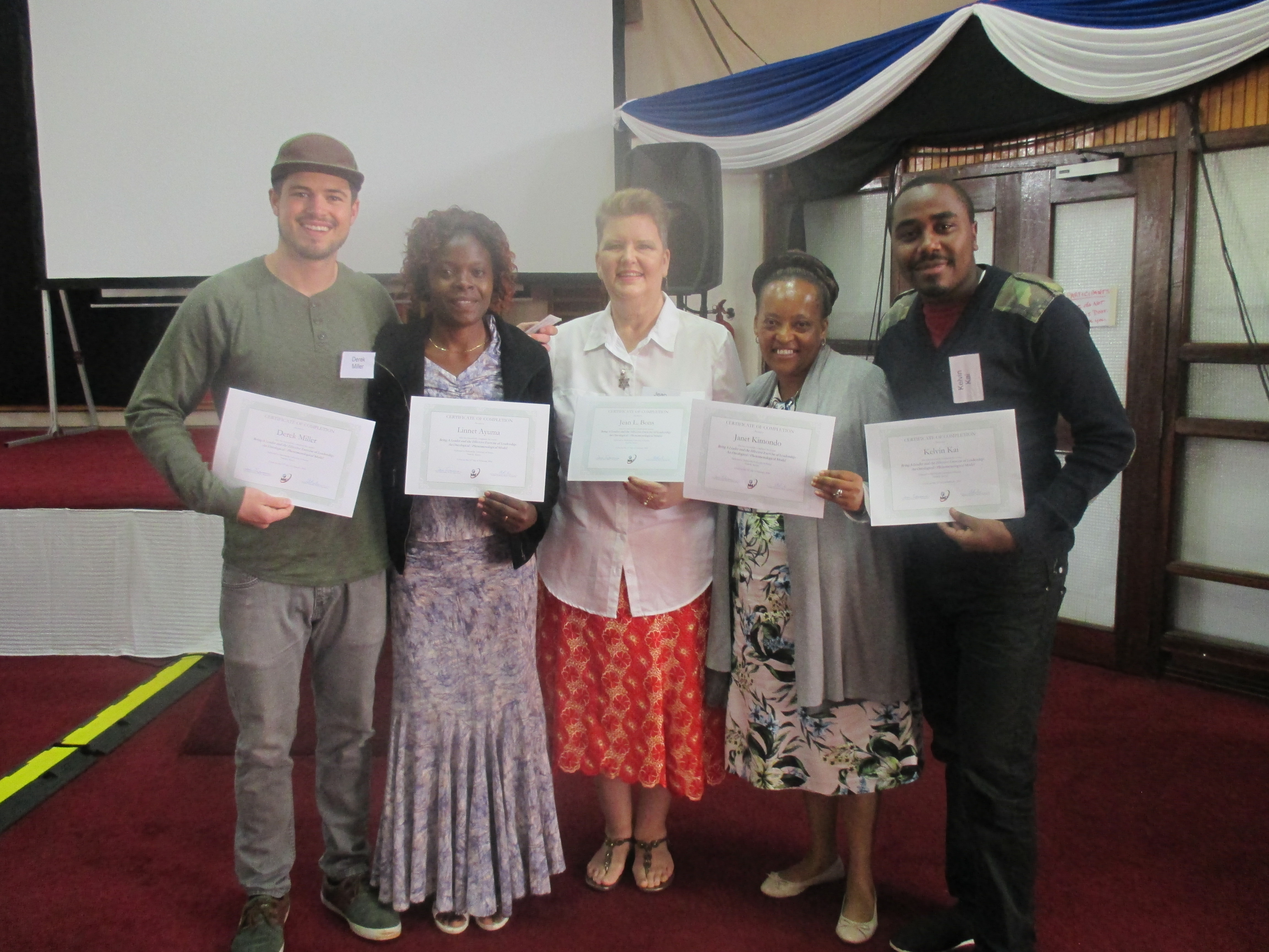 """Linnet Ayuma with participants at the Global Women's Leadership Network's week-long """"Being a Leader and Effective Exercise of Leadership"""" training."""