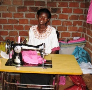 Village Enterprise female business owner in her sewing business