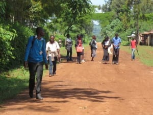 people walking along the road in Sitatunga village, Kenya
