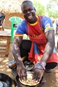 Business owner Julius making chapati