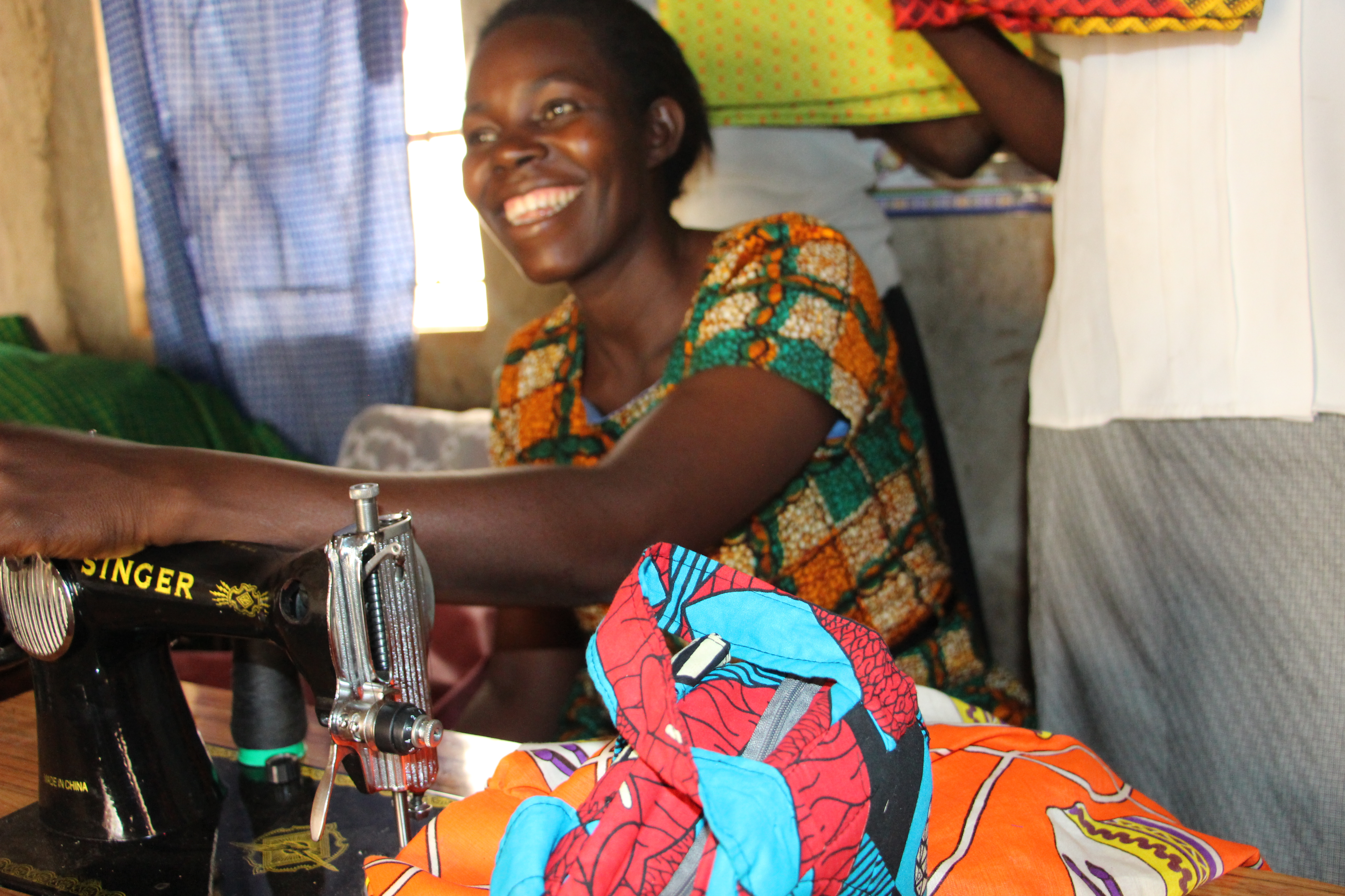 Village Enterprise business owner Rose Achieng at her sewing machine