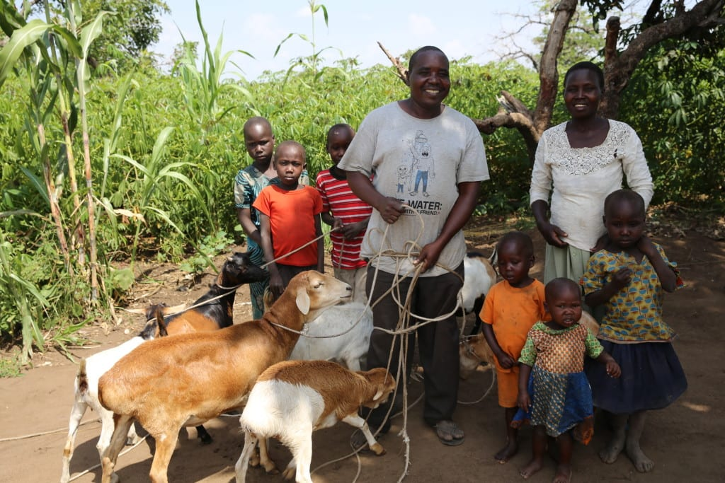 Joseph Ebwalu and his family and goats