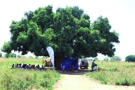 Family planning event under a tree in Africa