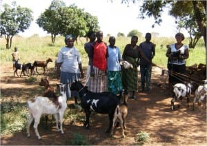 Village Enterprise female business owner, Lamaro Peace, her family, and her goats