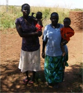 Village Enterprise female business owner, Lamaro Peace, and her family