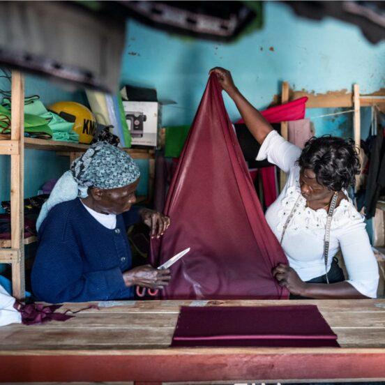Seamstress cutting cloth