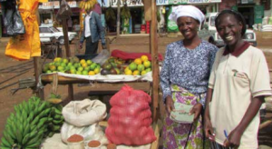 two Village Enterprise business owners and their market stall