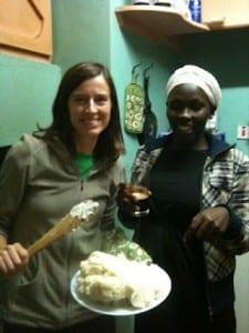 Kim and Florence making Ugali/Posho
