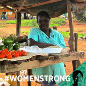 "African woman with the text ""#womenstrong"" overlaid"