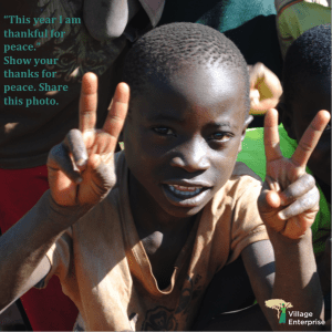 African boy make peace signs