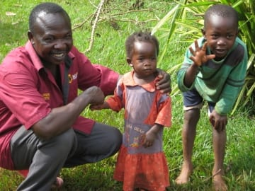 Jonah Isindu, Kenyan business owner, and his children