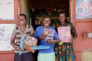 Village Enterprise young female entrepreneurs and their store