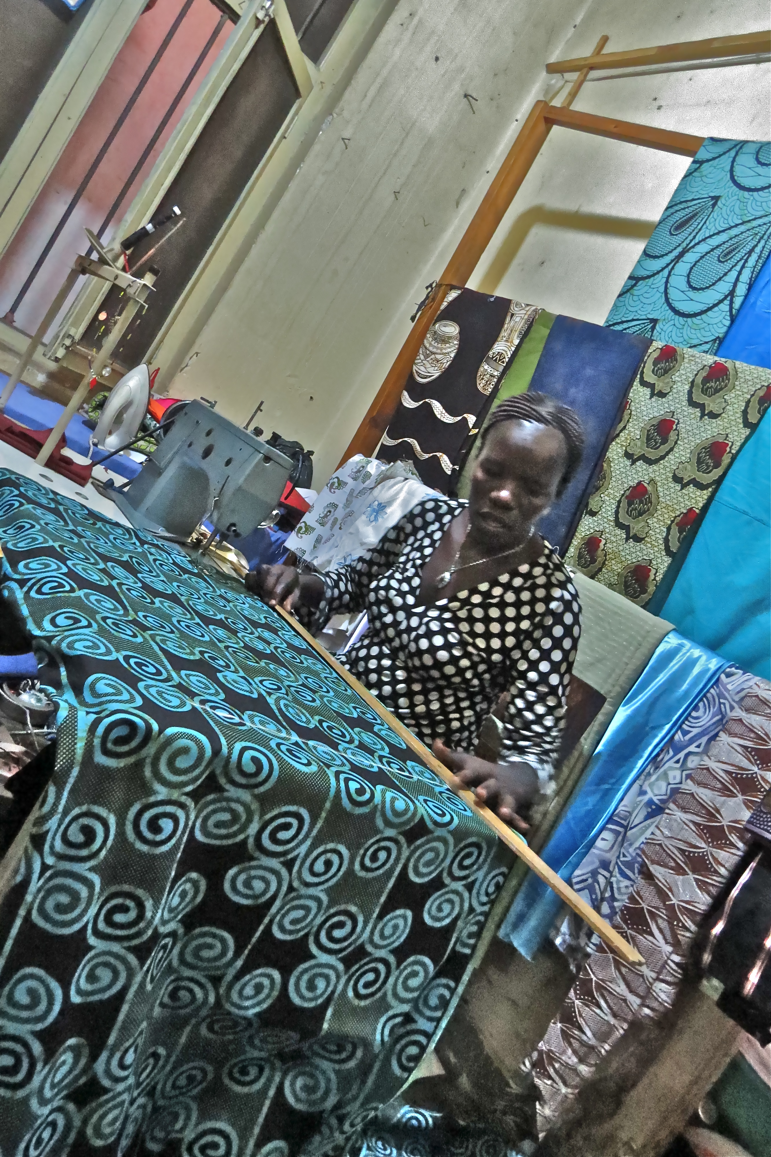 Village Enterprise business owner Hellen sewing