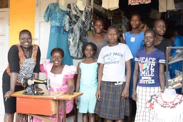 Helen, Village Enterprise business owner, and her shop