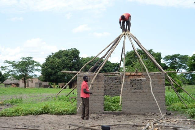 people building a hut