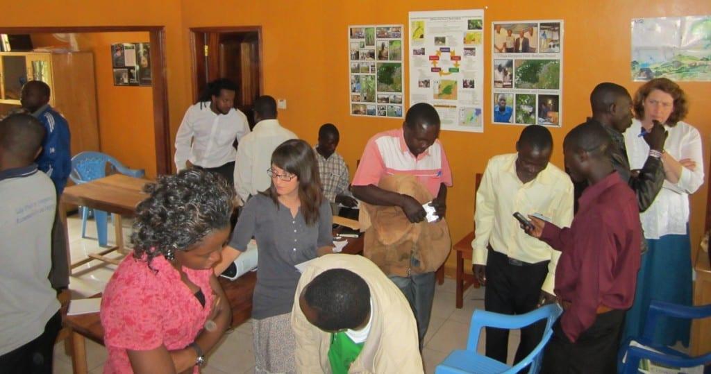 Village Enterprise Hoima, Uganda, staff talking